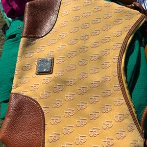 Dooney and Bourke used yellow purse! Authentic!
